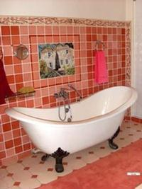 Nectarine coloured bathroom, personalized decoration and friezes
